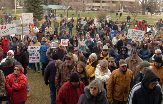 About 300 people gather in snow and freezing temperatures on Wednesday at City Park in downtown Cody to protest federal taxes and spending. The so-called tea party was one of thousands organized around the country aimed at drawing attention to public discontent with economic bailout and stimulus spending, as well as other issues.