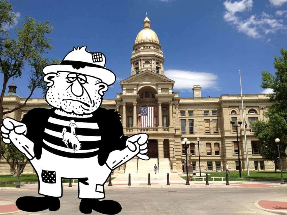 The state's busted budget poses outside the Capitol in Cheyenne.